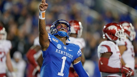 <p>               Kentucky quarterback Lynn Bowden Jr. (1) celebrates after throwing a touchdown pass during the second half of the team's NCAA college football game against Arkansas, Saturday, Oct. 12, 2019, in Lexington, Ky. (AP Photo/Bryan Woolston)             </p>