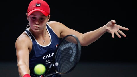 <p>               Ashleigh Barty of Australia hits a return shot against Petra Kvitova of the Czech Republic during the WTA Finals Tennis Tournament at the Shenzhen Bay Sports Center in Shenzhen, China's Guangdong province, Thursday, Oct. 31, 2019. (AP Photo/Andy Wong)             </p>