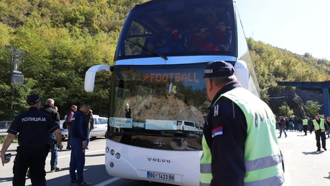 <p>               Serbian police officers guard a bus with Red Star players at the border crossing between Serbia and Kosovo, near the village of Rudnica, Serbia, Wednesday, Oct. 9, 2019. Kosovo authorities have banned a soccer match between Red Star Belgrade and a local Serb team and prevented their bus from crossing into the former Serbian province. (AP Photo/Bojan Slavkovic)             </p>