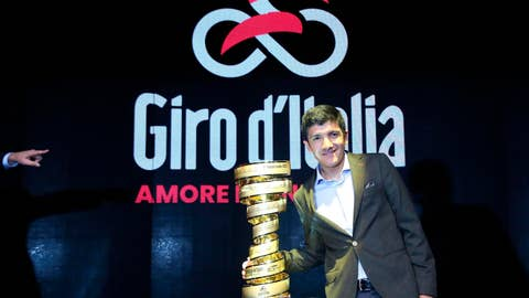 <p>               Ecuadorian rider Richard Carapaz poses with the 103rd cycling tour of Italy's trophy during the official presentation in Milan, northern Italy, Thursday, Oct. 24, 2019. The Giro d'Italia will start in Budapest with an 8.6km individual time trial. Twenty-one stages will be raced, first in Hungary and then Italy, from 9 to 31 May 2019, to crown the 2020's winner. (Matteo Bazzi/ANSA via AP)             </p>