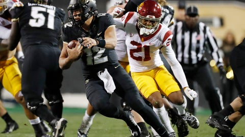 <p>               Colorado quarterback Steven Montez, left, avoids Southern California safety Isaiah Pola-Mao during the first half of an NCAA college football game Friday, Oct. 25, 2019, in Boulder, Colo. (AP Photo/David Zalubowski)             </p>