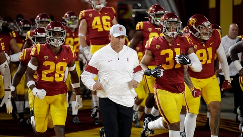 <p>               Southern California coach Clay Helton runs onto the field with this team for the start of an NCAA college football game against Arizona on Saturday, Oct. 19, 2019, in Los Angeles. (AP Photo/Marcio Jose Sanchez)             </p>