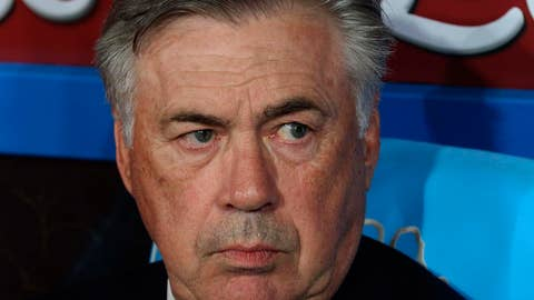 <p>               Napoli coach Carlo Ancelotti sits on the bench during the Italian Serie A soccer match between Napoli and Atalanta at the San Paolo stadium in Naples, Italy, Wednesday, Oct. 30, 2019. (Cesare Abbate/ANSA via AP)             </p>