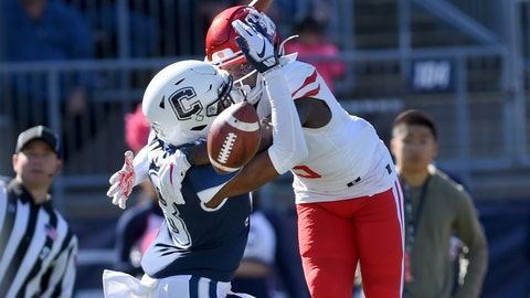 <p>               Connecticut defensive back Abiola Olaniyan (18) breaks up a pass intended for Houston wide receiver Marquez Stevenson (5) in the end zone during the first half of an NCAA college football game, Saturday, Oct. 19, 2019, in East Hartford, Conn. (AP Photo/Stephen Dunn)             </p>