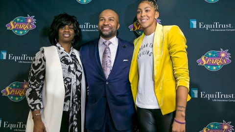 <p>               FILE - In this Dec. 7, 2018, file photo, Los Angeles Sparks executive vice president and general manager Penny Toler, left, newly named head coach Derek Fisher, center, and two-time WNBA Most Valuable Player Candace Parker pose for a photo during a news conference in Los Angeles. The WNBA is looking into an obscenity-laced speech that included racial epithets made by Los Angeles general manager Penny Toler in the locker room after the Sparks lost Game 2 of the WNBA semifinals in Connecticut. (AP Photo/Damian Dovarganes, File)             </p>