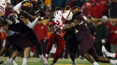<p>               Nebraska running back Maurice Washington tries to break through the tackle of Minnesota linebacker Thomas Barber during the second half of an NCAA college football game Saturday, Oct. 12, 2019, in Minneapolis. (AP Photo/Stacy Bengs)             </p>