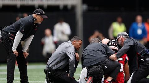 <p>               Atlanta Falcons head coach Dan Quinn watches medical teams attend to Atlanta Falcons running back Ito Smith (25) during the first half of an NFL football game against the Los Angeles Rams, Sunday, Oct. 20, 2019, in Atlanta. (AP Photo/John Bazemore)             </p>