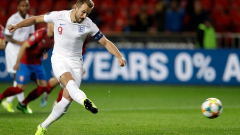 <p>               England's Harry Kane scores his side's opening goal from the penalty spot during the Euro 2020 group A qualifying soccer match between Czech Republic and England at the Sinobo stadium in Prague, Czech Republic, Friday, Oct. 11, 2019. (AP Photo/Petr David Josek)             </p>