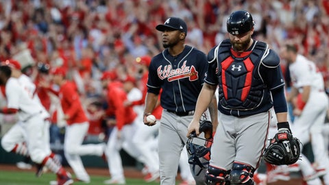 <p>               Atlanta Braves' Julio Teheran and catcher Brian McCann walk to the dugout after St. Louis Cardinals' Yadier Molina hit a sacrifice fly to score Kolten Wong for the winning run during the 10th inning in Game 4 of a baseball National League Division Series, Monday, Oct. 7, 2019, in St. Louis. (AP Photo, Charlie Riedel)             </p>