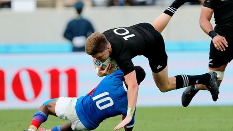 <p>               New Zealand's Jordie Barrett is tackled by Namibia's Helarius Kisting during the Rugby World Cup Pool B game at Tokyo Stadium between New Zealand and Namibia in Tokyo, Japan, Sunday, Oct. 6, 2019. (AP Photo/Christophe Ena)             </p>
