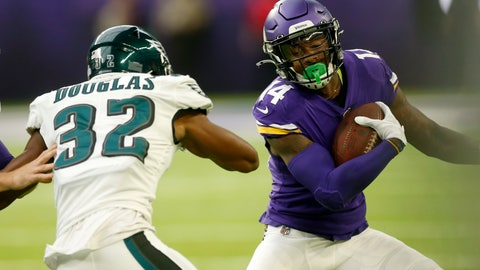 <p>               Minnesota Vikings wide receiver Stefon Diggs (14) runs from Philadelphia Eagles cornerback Rasul Douglas (32) during the first half of an NFL football game, Sunday, Oct. 13, 2019, in Minneapolis. (AP Photo/Jim Mone)             </p>