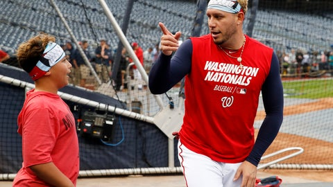 <p>               Meyer Cabrera, 12, left, talks with is dad Washington Nationals second baseman Asdrubal Cabrera during batting practice before Game 3 of the baseball World Series against the Houston Astros Friday, Oct. 25, 2019, in Washington. (AP Photo/Alex Brandon)             </p>