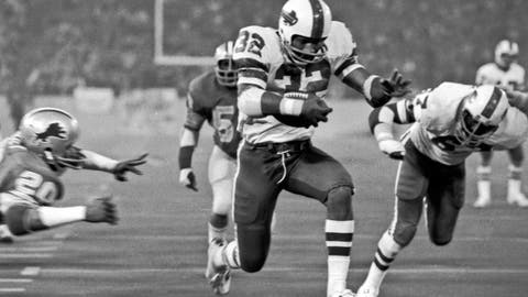 <p>               FILE - In this Nov. 25, 1976, file photo, Buffalo Bills' O.J. Simpson rushes through a large hole in the center ofthe Detroit Lions defensive line to score on a 12-yard run for his second touchdown in the NFL football game in Pontiac, Mich. The former Heisman Trophy winner from Southern Cal became the first player in NFL history to run for more than 2,000 yards in a season in 1973, finishing with 2,003 yards. (AP Photo/File)             </p>