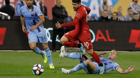 <p>               Toronto FC's Alejandro Pozuelo (10) fights for control of the ball with New York City FC's Alexander Ring, right, and Alexander Callens, left, during the first half of an MLS Eastern Conference soccer semifinal Wednesday, Oct. 23, 2019, in New York. (AP Photo/Frank Franklin II)             </p>