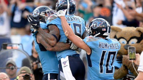 <p>               Tennessee Titans wide receiver Tajae Sharpe (19) celebrates with Adam Humphries (10) and Taylor Lewan, left, after Sharpe scored a touchdown against the Los Angeles Chargers in the second half of an NFL football game Sunday, Oct. 20, 2019, in Nashville, Tenn. (AP Photo/Mark Zaleski)             </p>