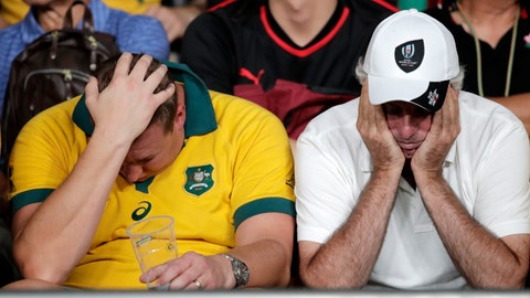 <p>               Australian supporters react following the Rugby World Cup Pool D game at Tokyo Stadium between Australia and Wales in Tokyo, Japan, Sunday, Sept. 29, 2019. Wales defeated Australia 29-25. (AP Photo/Jae Hong)             </p>