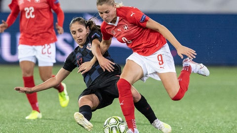 <p>               Switzerland's Ana Maria Crnogorcevic, right, fights for the ball against Croatia's Izabela Lojna during their UEFA European Women's Championship 2021 qualification round Group H soccer match between Switzerland and Croatia in Thun, Switzerland, Tuesday Oct. 8, 2019. (Peter Schneider/Keystone via AP)             </p>