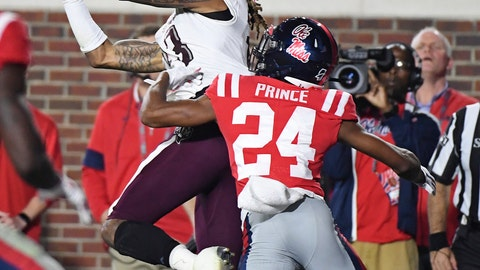 <p>               Texas A&M wide receiver Kendrick Rogers (13) catches a touchdown pass over Mississippi defensive back Deantre Prince (24) during the first half of an NCAA college football game in Oxford, Miss., Saturday, Oct. 19, 2019. (AP Photo/Thomas Graning)             </p>