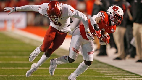 <p>               Utah running back Devonta'e Henry-Cole, right, carries the ball as Washington State cornerback Marcus Strong (4) defends in the second half of an NCAA college football game Saturday, Sept. 28, 2019, in Salt Lake City. (AP Photo/Rick Bowmer)             </p>