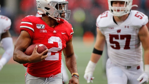 <p>               Ohio State running back J.K. Dobbins, left, outruns the Wisconsin defense for a touchdown during the second half of an NCAA college football game Saturday, Oct. 26, 2019, in Columbus, Ohio. Ohio State beat Wisconsin 38-7. (AP Photo/Jay LaPrete)             </p>