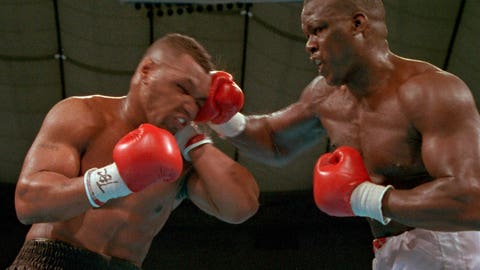 """<p>               FILE - In this Feb. 11, 1990, file photo, James """"Buster"""" Douglas, right, hits Mike Tyson with a hard right in the face during their world heavyweight title bout at the Tokyo Dome in Tokyo. Douglas is marking the 30th anniversary of his upset boxing victory over Tyson with a campaign aimed to inspiring others who face long odds. The 59-year-old plans to announce the """"42 to 1"""" initiative at the Ohio Statehouse Wednesday, Oct. 30, 2019, alongside city and state leaders and two-time Heisman Trophy winner Archie Griffin. The effort will include workforce development, diversity and self-help components.  (AP Photo/Sadayuki Mikami, File)             </p>"""