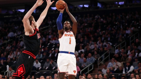 <p>               New York Knicks forward Bobby Portis (1) shoots as Chicago Bulls forward Luke Kornet (2) defends against him during the first half of an NBA basketball game in New York, Monday, Oct. 28, 2019. (AP Photo/Kathy Willens)             </p>