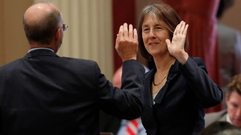 """<p>               FILE - In this Sept. 11, 2019, file photo, state Sen. Nancy Skinner, D-Berkeley and state Sen. Steven Glazer, D-Orinda slap palms in celebration after her measure to let athletes at California colleges hire agents and sign endorsement deals was approved by the Senate in Sacramento, Calif. The NCAA Board of Governors took the first step Tuesday, Oct. 29, 2019, toward allowing athletes to cash in on their fame, voting unanimously to clear the way for the amateur athletes to """"benefit from the use of their name, image and likeness.""""  (AP Photo/Rich Pedroncelli, File)             </p>"""