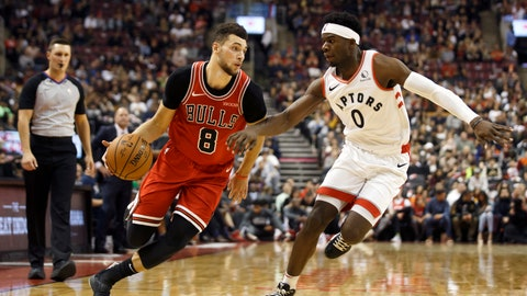 <p>               Chicago Bulls guard Zach LaVine (8) drives against Toronto Raptors guard Terence Davis (0) during the first half of their NBA basketball game in Toronto, Sunday, Oct. 13, 2019. (Cole Burston/The Canadian Press via AP)             </p>