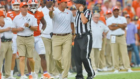 <p>               Clemson head coach Dabo Swinney, center, discusses a call with an official during the first half of an NCAA college football game against Florida State Saturday, Oct. 12, 2019, in Clemson, S.C. (AP Photo/Richard Shiro)             </p>