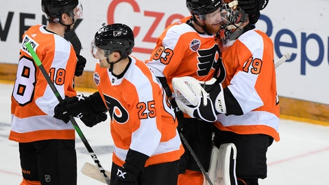 <p>               Philadelphia Flyers, from left, Tyler Pitlick, James van Riemsdyk, Jakub Voracek and Carter Hart, celebrate after they beat the Chicago Blackhawks 4-3 in an NHL Global Series ice hockey game in Prague, Czech Republic, Friday, Oct. 4, 2019. (Ondrej Deml/CTK via AP)             </p>