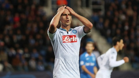 <p>               Napoli's Arkadiusz Milik reacts after missing a scoring chance during a Champions League group E soccer match between Genk and Napoli at the KRC Genk Arena in Genk, Belgium, Wednesday, Oct. 2, 2019. (AP Photo/Francisco Seco)             </p>