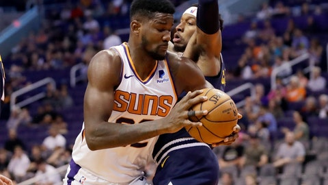 <p>               Phoenix Suns center Deandre Ayton (22) tries to drive past Denver Nuggets forward Torrey Craig during the second half of an NBA preseason basketball game, Monday, Oct. 14, 2019, in Phoenix. (AP Photo/Matt York)             </p>