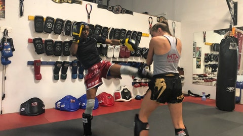 """<p>               In this photo taken Oct. 11, 2019, California women's basketball coach Charmin Smith spars with Alexa Terry during a Muay Thai boxing class in Oakland, Calif. """"It's definitely my passion outside of basketball. I've found a whole new community. I have new teammates, new family with our Muay Thai-minded family and Coach Jay,"""" Smith says. """"And it's been truly phenomenal and I've learned another level of discipline and commitment. The technique and the skill that it takes to learn the art of Muay Thai has definitely made me a better basketball coach."""" (AP Photo/Janie McCauley)             </p>"""