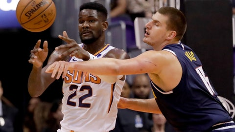 <p>               Phoenix Suns center Deandre Ayton (22) dishes off as Denver Nuggets center Nikola Jokic defends during the first half of an NBA preseason basketball game, Monday, Oct. 14, 2019, in Phoenix. (AP Photo/Matt York)             </p>