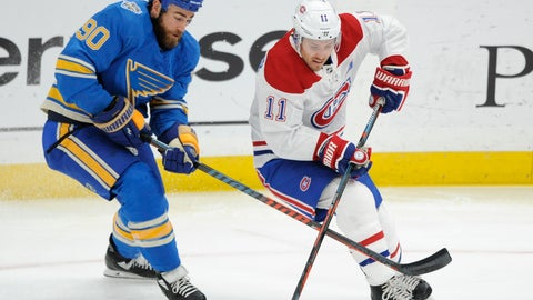 <p>               Montreal Canadiens' Brendan Gallagher (11) reaches for the puck with St. Louis Blues' Ryan O'Reilly (90) during the first period of an NHL hockey game, Saturday, Oct. 19, 2019, in St. Louis. (AP Photo/Bill Boyce)             </p>