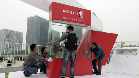 <p>               Workers dismantle signage for an NBA fan event scheduled to be held on Wednesday night at the Shanghai Oriental Sports Center in Shanghai, China, Tuesday, Oct. 8, 2019. Chinese state broadcaster CCTV announced Tuesday it will no longer air two NBA preseason games set to be played in the country. (AP Photo)             </p>