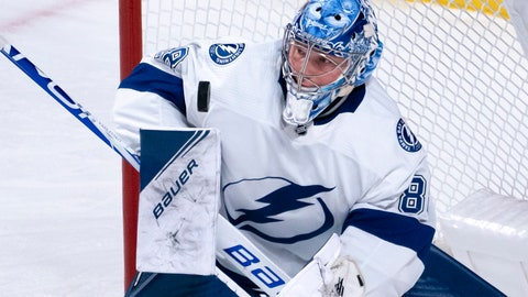 <p>               Tampa Bay Lightning goaltender Andrei Vasilevskiy blocks a Montreal Canadiens shot during the second period of an NHL hockey game Tuesday, Oct. 15, 2019, in Montreal. (Paul Chiasson/The Canadian Press via AP)             </p>