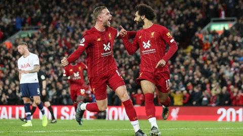 <p>               Liverpool's Mohamed Salah, right, celebrates with his teammate Jordan Henderson after scoring his side's second goal during the English Premier League soccer match between Liverpool and Tottenham Hotspur at Anfield stadium in Liverpool, England, Sunday, Oct. 27, 2019. (AP Photo/Jon Super)             </p>