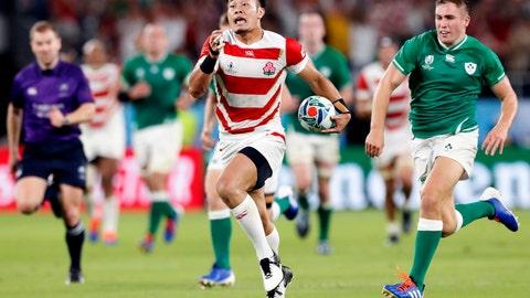 <p>               Japan's Kenki Fukuoka, center,  runs past Ireland's defense during the Rugby World Cup Pool A game at Shizuoka Stadium Ecopa between Japan and Ireland in Shizuoka, Japan, Saturday, Sept. 28, 2019. (Naoya Osato/Kyodo News via AP)             </p>
