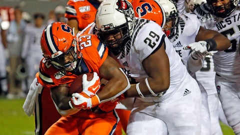 <p>               North Carolina State's Alim McNeill (29) ties up Syracuse's Abdul Adams (23) during the first half of an NCAA college football game in Raleigh, N.C., Thursday, Oct. 10, 2019. (AP Photo/Karl B DeBlaker)             </p>