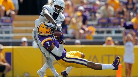 <p>               FILE - In this Oct. 5, 2019, file photo, LSU safety Grant Delpit (7) pulls in an interception against Utah State wide receiver Savon Scarver in the second half of an NCAA college football game in Baton Rouge, La. Delpit was selected to the AP Midseason All-America NCAA college football team, Tuesday, Oct. 15, 2019.  (AP Photo/Gerald Herbert, File)             </p>