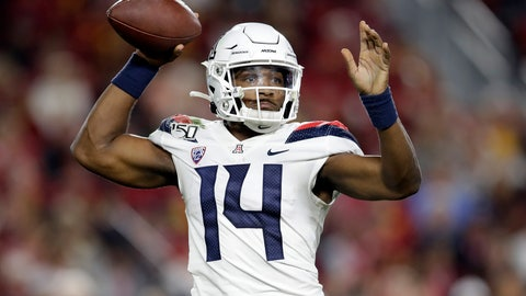 <p>               Arizona quarterback Khalil Tate (14) throws against Southern California during the first half of an NCAA college football game Saturday, Oct. 19, 2019, in Los Angeles. (AP Photo/Marcio Jose Sanchez)             </p>