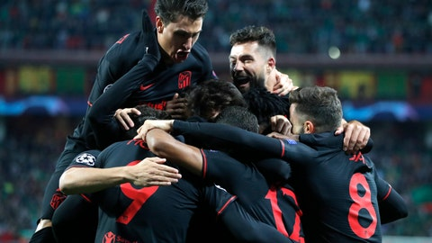 <p>               Atletico players celebrate after Atletico Madrid's Joao Felix scored his side's opening goal during the Champions League Group D soccer match between Lokomotiv Moscow and Atletico Madrid at the Lokomotiv Stadium in Moscow, Russia, Tuesday, Oct. 1, 2019. (AP Photo/Pavel Golovkin)             </p>