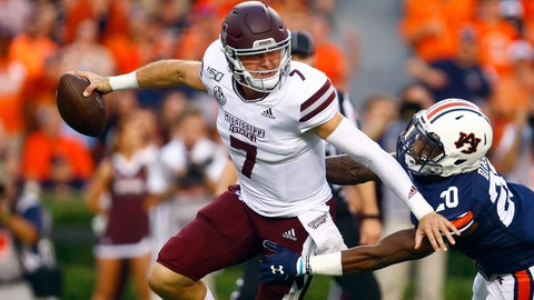 <p>               Mississippi State quarterback Tommy Stevens (7) is sacked by Auburn defensive back Jeremiah Dinson (20) during the first half of an NCAA college football game, Saturday, Sept. 28, 2019, in Auburn, Ala. (AP Photo/Butch Dill)             </p>