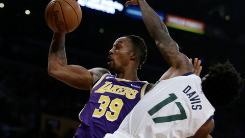<p>               Los Angeles Lakers center Dwight Howard, left, rebounds the ball next to Utah Jazz center Ed Davis during the first half of an NBA basketball game in Los Angeles, Friday, Oct. 25, 2019. (AP Photo/Alex Gallardo)             </p>