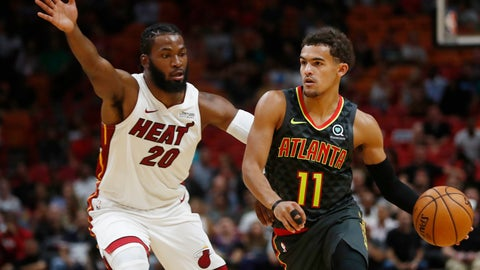 <p>               Atlanta Hawks guard Trae Young (11) dribbles against Miami Heat forward Justise Winslow (20) during the first half of an NBA preseason basketball game Monday, Oct. 14, 2019, in Miami. (AP Photo/Brynn Anderson)             </p>