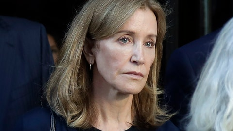 <p>               FILE - This Sept. 13, 2019 file photo shows actress Felicity Huffman leaving federal court after her sentencing in a nationwide college admissions bribery scandal in Boston. A representative for Huffman says she reported to a federal prison in California to serve a two-week sentence on Tuesday, Oct. 15. Last month a federal judge in Boston sentenced Huffman to 14 days in prison, a $30,000 fine, 250 hours of community service and a year's probation after she pleaded guilty to fraud conspiracy for paying an admissions consultant $15,000 to have a proctor correct her daughter's SAT answers. (AP Photo/Elise Amendola, File)             </p>