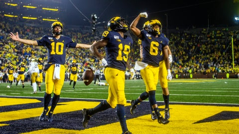 <p>               Michigan wide receiver Mike Sainristil (19) celebrates his 26-yard touchdown reception from Michigan quarterback Dylan McCaffrey (10), alongside wide receiver Cornelius Johnson (6) in the fourth quarter of an NCAA college football game against Notre Dame in Ann Arbor, Mich., Saturday, Oct. 26, 2019. Michigan won 45-14. (AP Photo/Tony Ding)             </p>