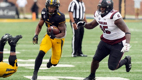 <p>               Missouri running back Tyler Badie, left, runs past South Carolina defensive lineman Kobe Smith, right, during the third quarter of an NCAA college football game, Saturday, Sept. 21, 2019, in Columbia, Mo. (AP Photo/L.G. Patterson)             </p>