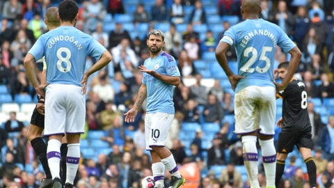 <p>               Manchester City's Sergio Aguero, center, reacts towards team mates after Wolverhampton Wanderers' Adama Traore's scored his second goal during the English Premier League soccer match between Manchester City and Wolverhampton Wanderers at Etihad stadium in Manchester, England, Sunday, Oct. 6, 2019. (AP Photo/Rui Vieira)             </p>